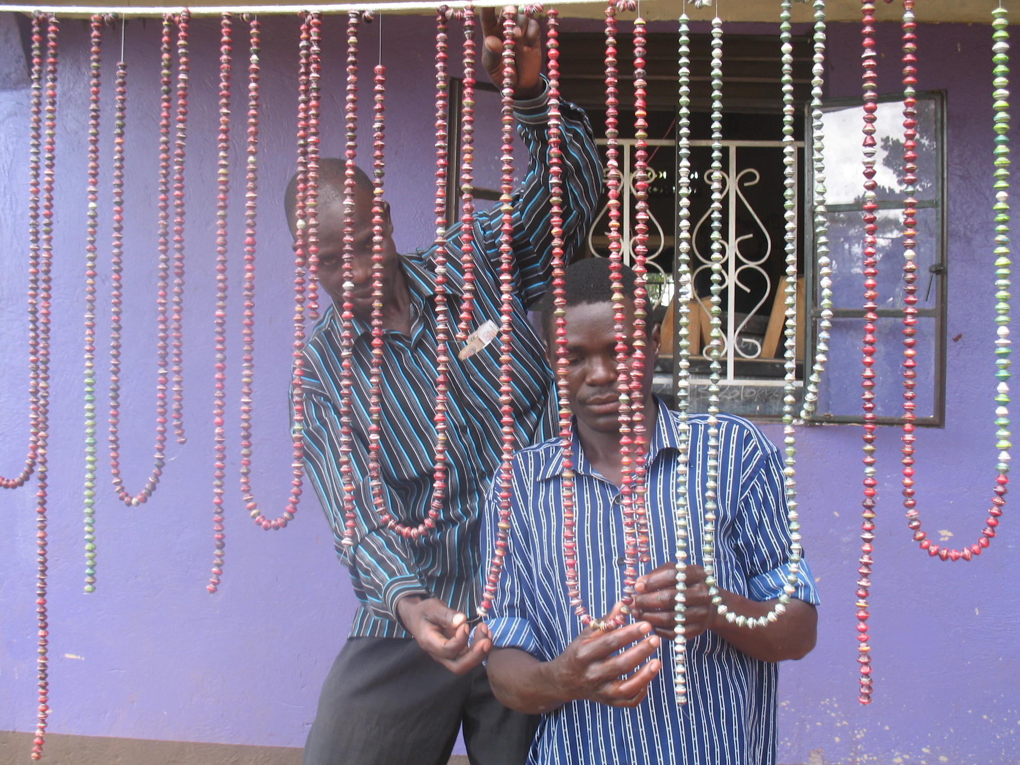 Men hanging strands of beads