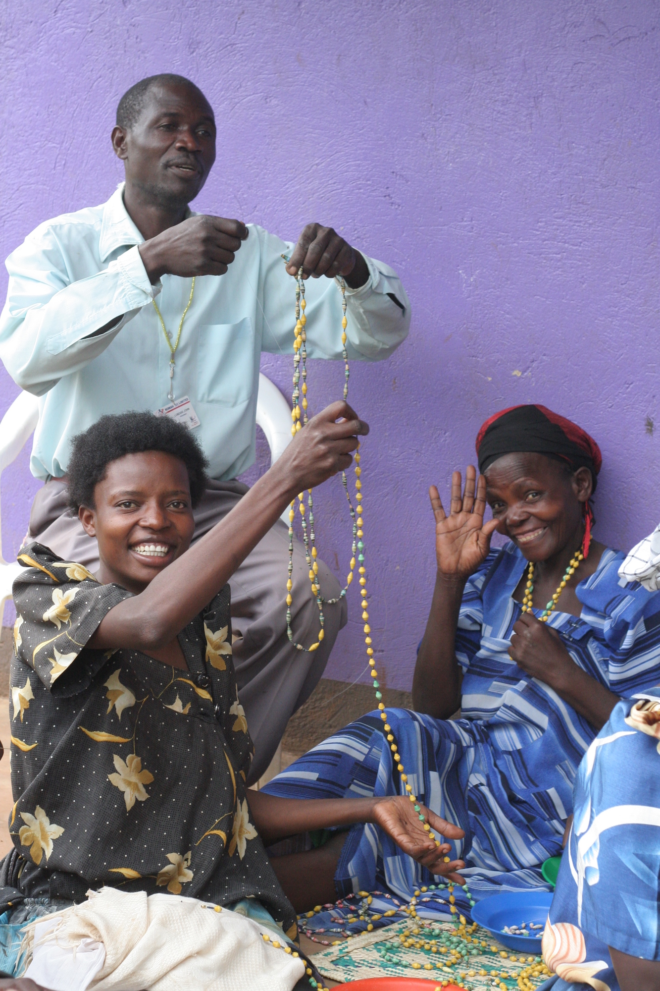 People holding strands of beads