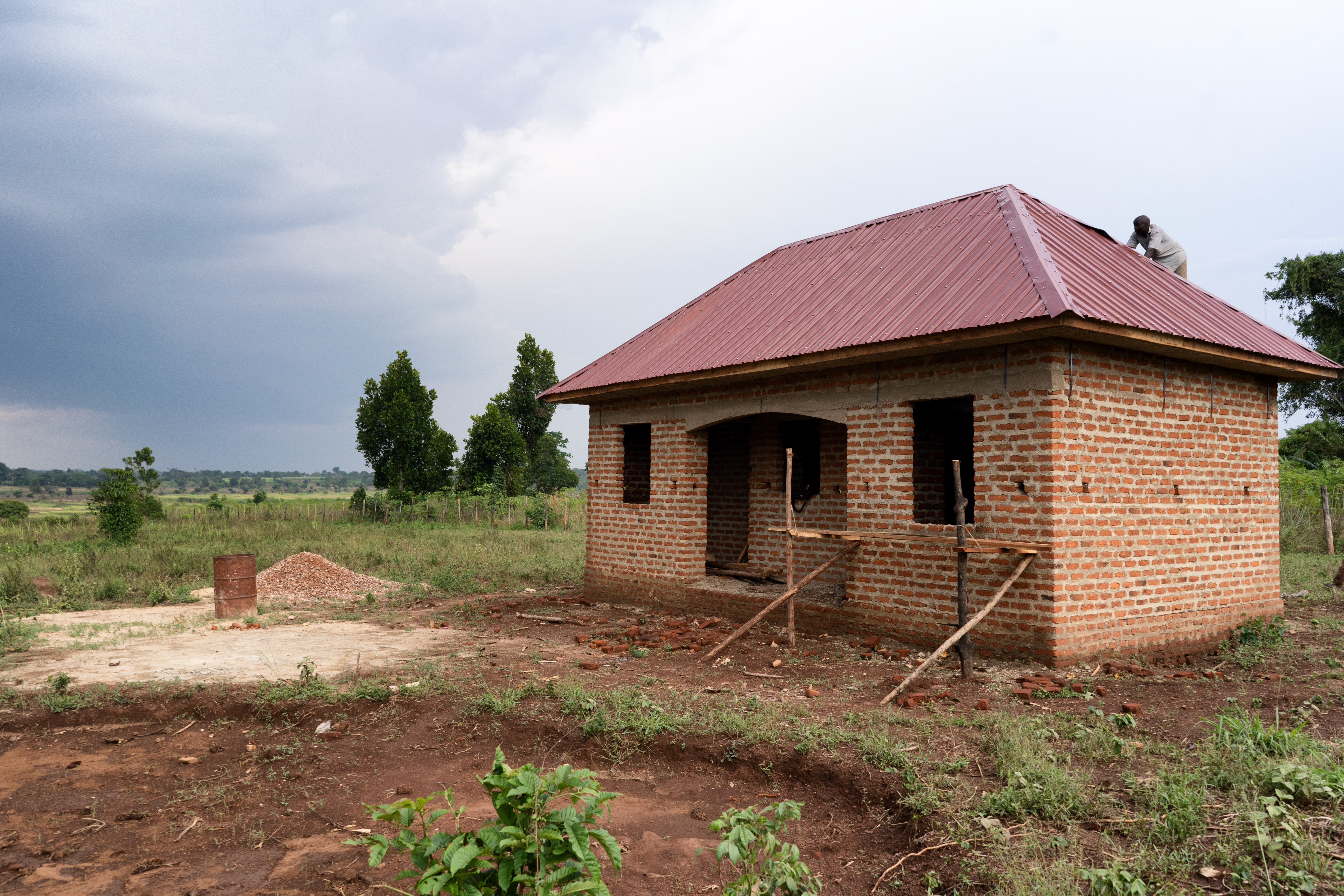 A brick house being built