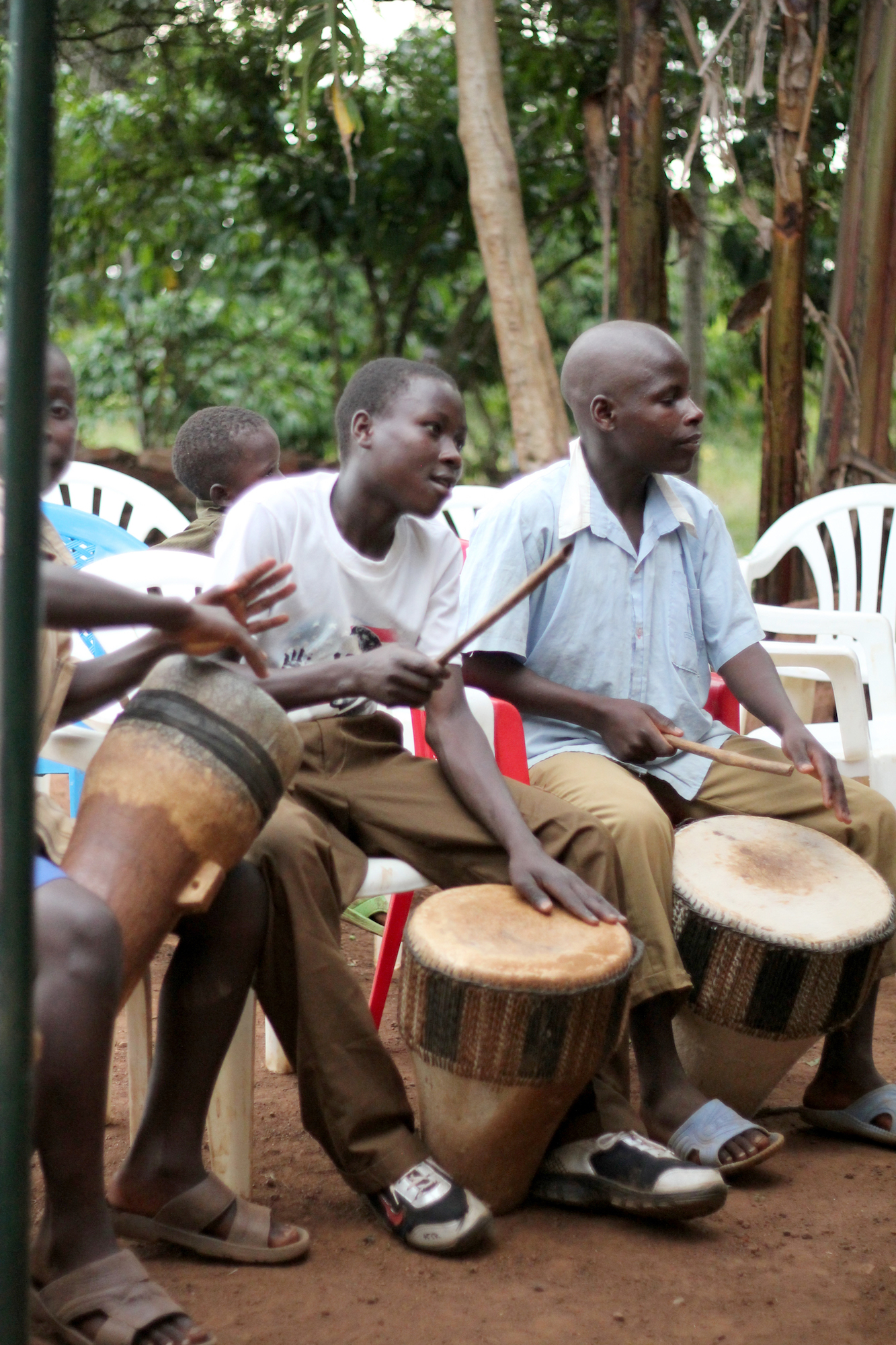 Two young men playing drums