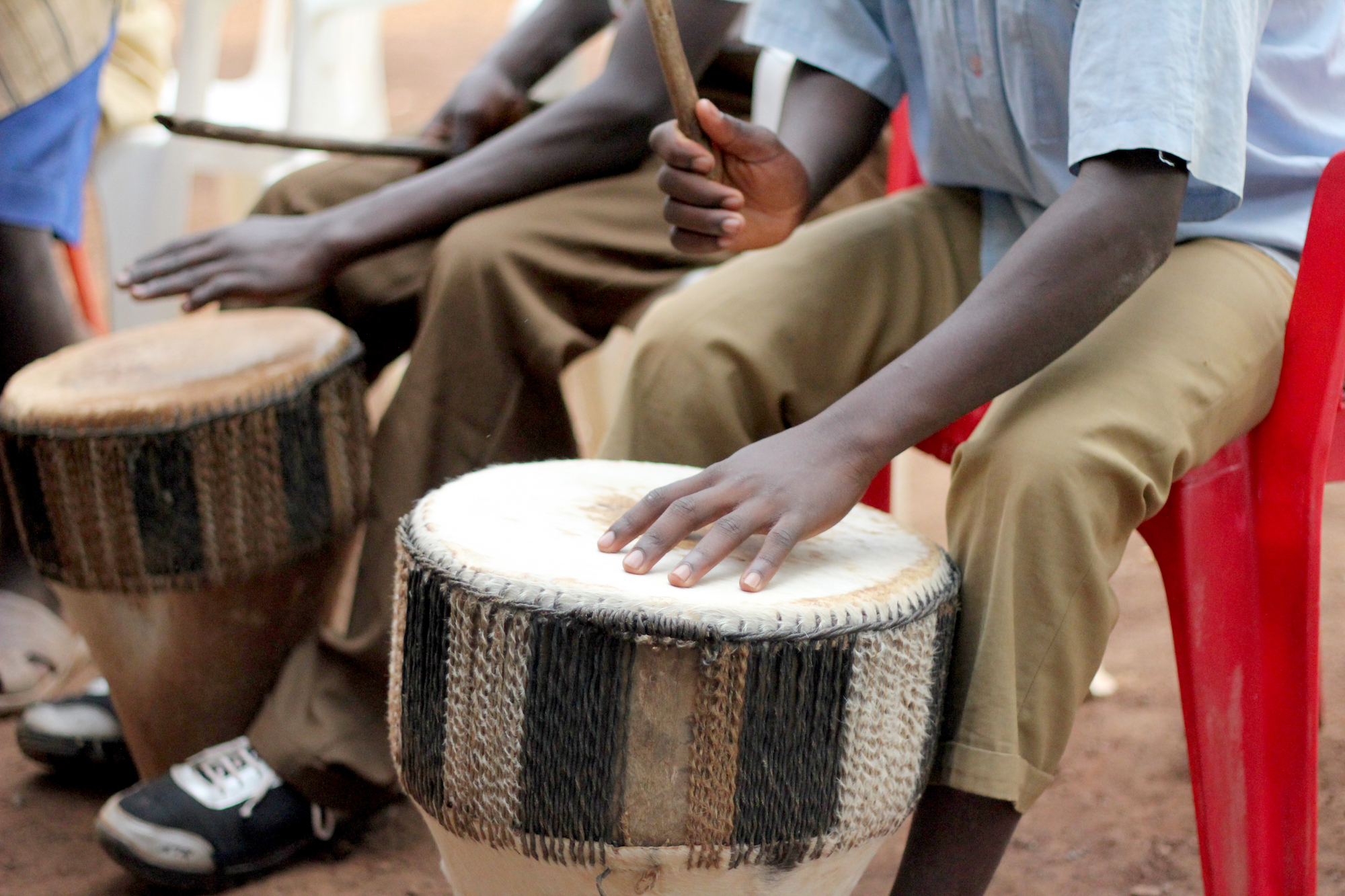 Close up of young men playing drums