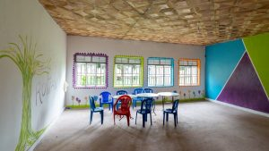 A desk with chairs in a classroom in Uganda