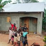 A ROWAN family in Uganda in front of the new home that was built for them.